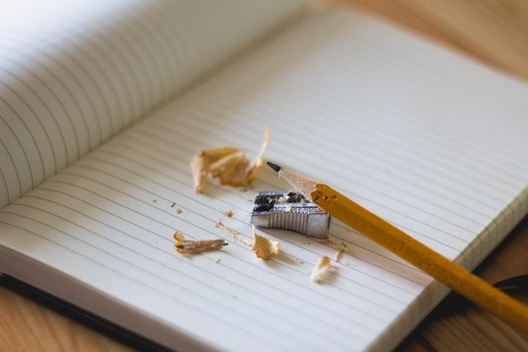 pencil, sharpener, and paper