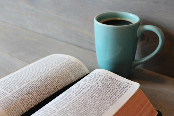 bible with blue coffee cup