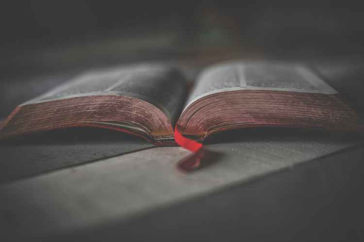 bible open with red bookmark
